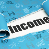 Income written on Blue paper