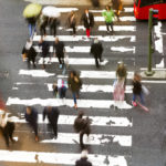 a bunch of pedestrians crossing the street.jpg.crdownload