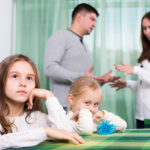Family of four having quarrel at home