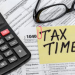tax form with calculator and glasses