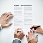 young man an woman signing a prenuptial agreement